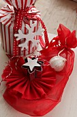 Christmas presents wrapped in red and white with hand-crafted gift tags
