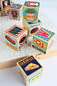 Wooden toy blocks with illustrations of food and letters