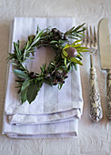 Small herb wreath decorating napkin