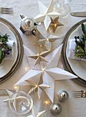 Handmade origami Christmas stars on table