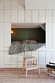 Floor-to-ceiling fitted cupboards and cubby bed in child's bedroom