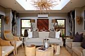 Elegant sofa set and armchairs around tree-stump coffee tables in lounge area