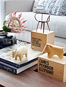 Miniature models of designer objects on top of labelled wooden boxes
