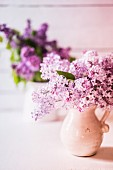 Bouquet of lilacs in ceramic jugs