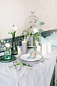 Fairy-tale dining table decorated for wedding with birdcage and many candles