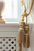 Golden cord curtain tie-backs with tassels