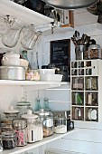 Vintage jars and glass scoops on storage shelves