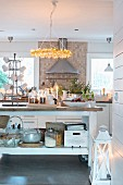 Cosily lit, vintage-style kitchen with island counter