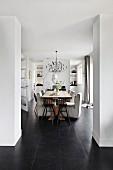 Modern dining set on dark grey tiled floor