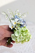 Spring posy of violas, lily of the valley, forget-me-nots & hydrangeas