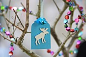 Hand-made paper gift tag with moose motif