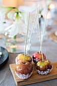 Toffee apples with desiccated coconut on board