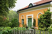 Traditional country house with yellow-painted façade
