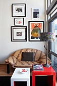 Cubic coffee tables in front of striped leather sofa below gallery of pictures on wall