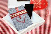 Hand-made felt mobile phone case decorated with ruffled ribbon and love-heart