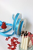 Craft utensils & decorations: ribbons, decorative numbers, toadstool ornament, pine cones & candles