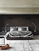 Masculine bedroom with dark wooden wall and concrete ceiling