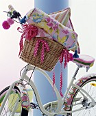 Bicycle with pretty motifs on mud guards and cushions and blanket in basket
