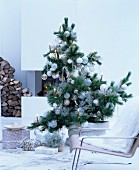 Christmas tree decorated with white baubles