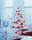 LED tree decorated with red and silver baubles