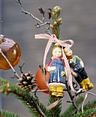Hansel and Gretel baubles decorating the top of a Christmas tree