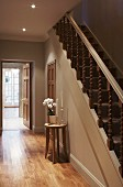 Hallway in natural shades with traditional, wooden staircase