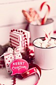 Speech bubble reading 'Merry Christmas', sweeties and red and white gift box