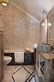 Mosaic tiles and rustic washstand in Oriental attic bathroom
