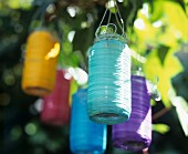 Lanterns of various colours hanging in tree
