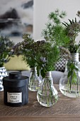 Flowers and twigs in vases made from old light bulbs