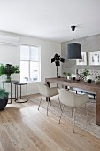 Modern furniture and concrete-effect wall in Scandinavian dining room