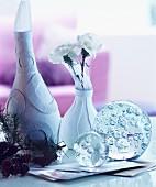 Winter arrangement of vases and glass baubles