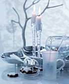 Festive, white and silver table arrangement with dish and glass candlesticks
