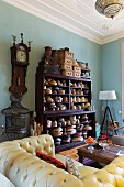 Hat blocks on shelving and yellow Chesterfield sofa in living room
