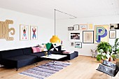 Charcoal sofa combination and gallery of pictures in spacious living area with Scandinavian retro ambiance