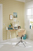 A desk against a wall with golden and yellow-green ornamental patterned wallpaper