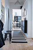 Black and white furniture in hallway and dining room