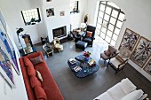View down into eclectic living area in renovated country house modern ambiance