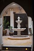 Courtyard with Arabian-style, stone fountain