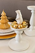 White bear ornament and gold baubles on candlestick