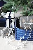 Gifts in blue baskets below Christmas tree