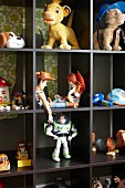 Toy figurines in dark wooden display case