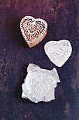 A heart-shaped stamp embossed in aluminium foil