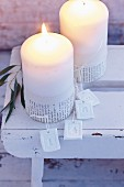 Pillar candles for Advent decorated with sleeves of text
