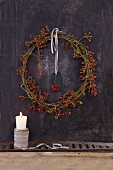 A homemade autumnal rose-hip wreath