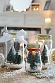 Miniature Christmas trees in jars