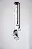 Pendant lamp group with dark wire shades in different shapes