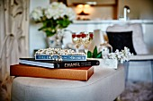 Bead necklace on top of books stacked on footstool
