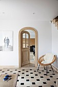 Open arched door in foyer with old tiled floor