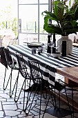 Graphic pattern mix at the dining table with a striped tablecloth